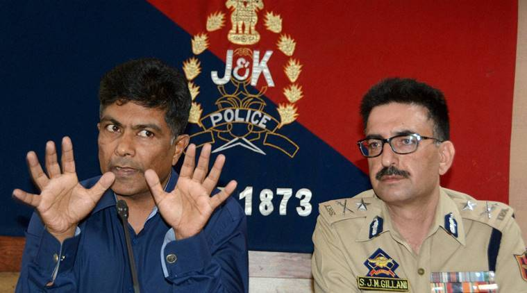 Srinagar: Additional Director General of Jammu and Kashmir Police S.M Sahai (R) with Inspector General of J&K Police J.M Geelani addresses a press conference regarding the on going situation of Kashmir in which eight protesters were killed and hundred's including 96 security personnel were injured in day-long clashes which erupts following the killing of most wanted HM militant Commander Burhan Wani,at Police Control Room in Srinagar on Saturday. PTI Photo (PTI7_9_2016_000235B)