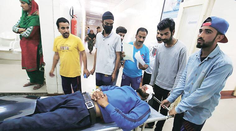 An injured man being brought to a hospital in Srinagar on Sunday. (Source: Shuaib Masoodi)
