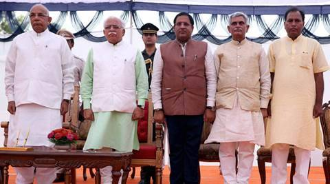 Chandigarh: Haryana Governor Prof Kaptan Singh Solanki and Chief Minister Manohar Lal Khattar with newly inducted Ministers Vipul Goyal, Manish Grover and Dr Banwari Lal after oath ceremony at Raj Bhawan in Chandigarh on Friday. PTI Photo  (PTI7_22_2016_000251B)
