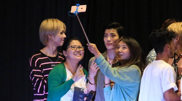Fans take a selfie with members of IMFACT, a K-pop band, in Gangtok during the regional finals of the 2016 K-Pop India contest. (Source: Express photo by Rinchen Dorjee Lepcha)