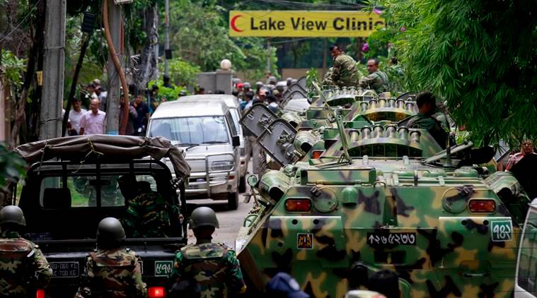 Bangladesh security personnel stand on top of armored vehicles after militants took hostages at a restaurant popular with foreigners in Dhaka, Bangladesh, Saturday, July 2, 2016. Bangladeshi forces stormed the Holey Artisan Bakery in Dhaka's Gulshan area where heavily armed militants held dozens of people hostage Saturday morning, rescuing some captives including foreigners at the end of the 10-hour standoff. (AP Photo)