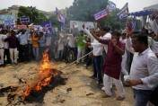 Bahujan Samaj Party (BSP) supporters burn an effigy of Bharatiya Janata Party (BJP) during a protest in Lucknow, Uttar Pradesh state, India, Thursday, July 21, 2016. The protestors are demanding the arrest of BJP's former state vice president Dayashanakar Singh for making derogatory remarks against BSP chief Mayawati.(AP Photo/Rajesh Kumar Singh)