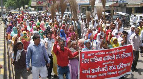 Gurgaon: Sweepers of Municipal Corporation of Gurgaon demanding regularisation of their jobs in Gurgaon on Wednesday. PTI Photo (PTI7_20_2016_000233A)