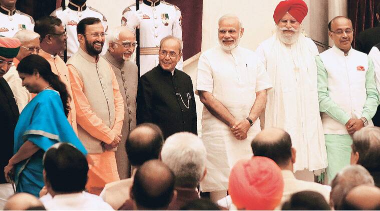 President Pranab Mukherjee, Prime Minister Narendra Modi with the new ministers during the swearing-in ceremony at Rashtrapati Bhavan in New Delhi on Tuesday. (Source: Express photo by Neeraj Priyadarshi)