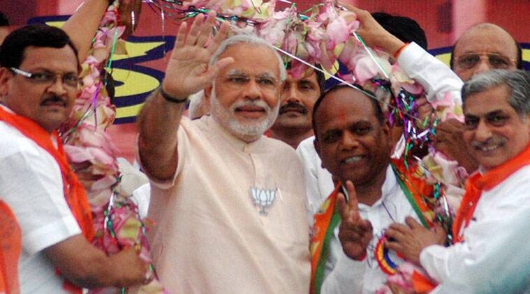 PM Narendra Modi with Mansukhbhai Vasava at a rally. (Source: PTI/File)