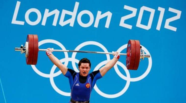 Russia's Natalya Zabolotnaya lifts on the women's 75Kg group A weightlifting competition at the ExCel venue at the London 2012 Olympic Games