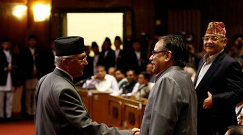 Nepal's Prime Minister Khadga Prasad Sharma Oli, also known as KP Oli, shakes hand with Chairman of the Unified Communist Party of Nepal (Maoist) Pushpa Kamal Dahal, also known as Prachanda, (R) as he returns after announcing his resignation at the parliament in Kathmandu, Nepal, July 24, 2016. REUTERS/Navesh Chitrakar