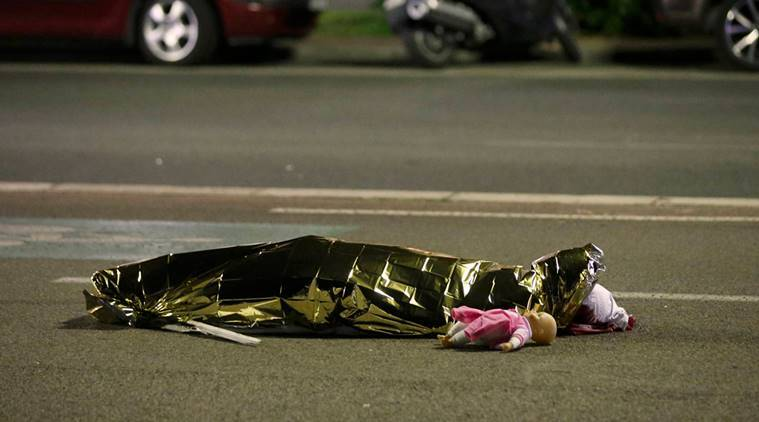 ATTENTION EDITORS - VISUAL COVERAGE OF SCENES OF INJURY OR DEATH - A body is seen on the ground July 15, 2016 after at least 30 people were killed in Nice, France, when a truck ran into a crowd celebrating the Bastille Day national holiday July 14. REUTERS/Eric Gaillard REUTERS/Eric Gaillard TPX IMAGES OF THE DAY