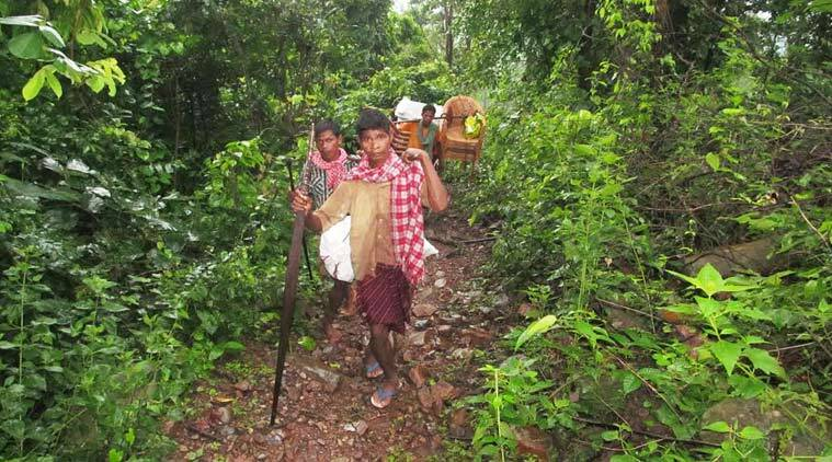 the long trek to Nagada village, which a few officials only recently made after reports emerged of the deaths. Debabrata Mohanty