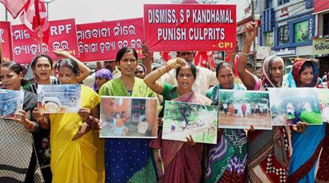 Bhubaneswar: CPI activists hold a protest rally against the killing of five innocent tribals in police firing during an anti-Maoist operation in Kandhamal, in Bhubaneswar on Wednesday.   PTOI Photo (PTI7_13_2016_000029A)
