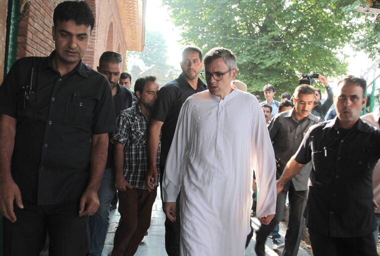 Former J-K Chief Minister Omar Abdullah on Wednesday travelled to Srinagar's martyrs graveyard to pay tributes to the 22 Kashmiris who were killed during protests by Dogra forces. State observes July 13 as Martyrs' Day. .Express Photo by Shuaib Masoodi