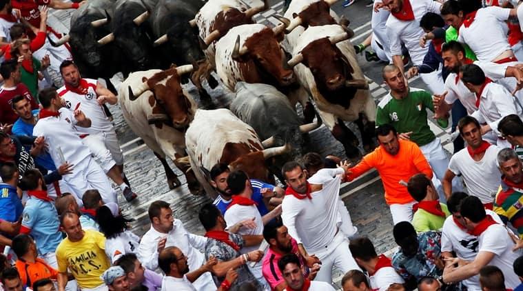 san fermin festival, bull-running festival, spain, pamplona, red cross, bull, world news, indian express