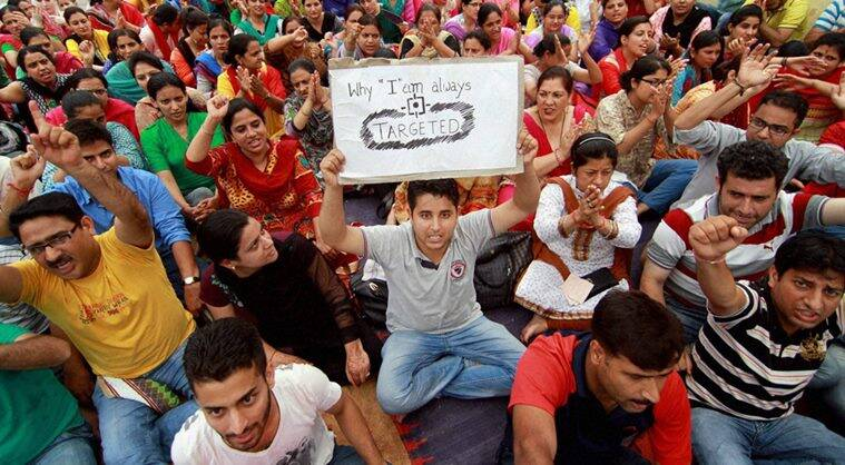 Jammu: Kashmiri Pandits under the banner of All Migrant Employees Association hold a protest demonstration outside the Relief Commissioner's Office against clashes at different places in the Valley in Jammu on Monday. PTI Photo(PTI7_25_2016_000157B)
