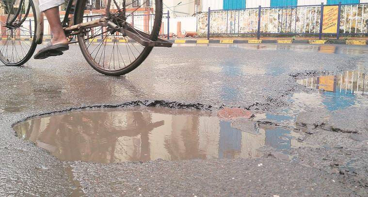 UP road construction, UP PWD, UP road pot-holes, Yogi Adityanath, Adityanath on construction of roads, indian express news