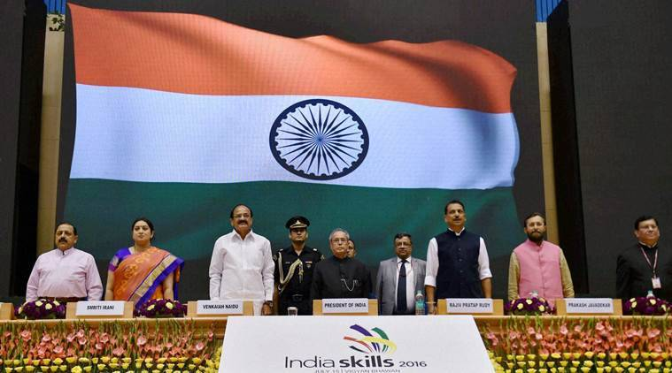 "New Delhi: President Pranab Mukherjee with Union Ministers Venkaiah Naidu, Smriti Irani, Prakash Javadekar, Jitendra Singh and Rajiv Pratap Rudy stands for the national anthem at the inauguration of First Edition of ""India Skills 2016"" on the occasion of World Youth Skills Day, in New Delhi on Friday. PTI Photo by Vijay Verma (PTI7_15_2016_000350A)"