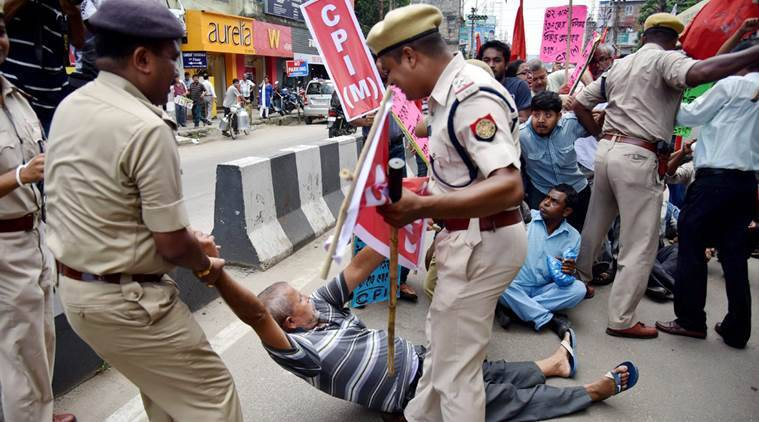 Guwahati : Left parties activists being detained by the police personnel during a protest against the government's move to privatize 12 Oil fields of Assam, in Guwahati on Friday. PTI Photo (PTI7_15_2016_000318A)