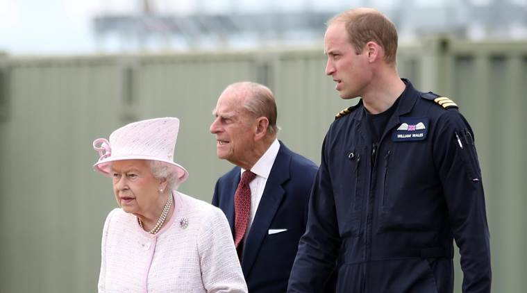 Britain's Queen Elizabeth II and Prince Philip are met by Prince William as they arrive to open the new base of East Anglian Air Ambulance at Cambridge Airport, Cambridge, England, Wednesday July 13, 2016. (Chris Radburn/PA via AP)