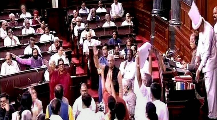 New Delhi: Opposition members protest in front of Deputy Chairman of Rajya Sabha P.J. Kurien during the Monsoon Session of parliament in New Delhi on Tuesday. PTI Photo / TV GRAB (PTI7_26_2016_000224A)