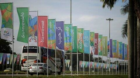 Flags with welcome messages in several languages advertising the 2016 Rio Olympics are pictured on Rio de Janeiro's international airport driveway