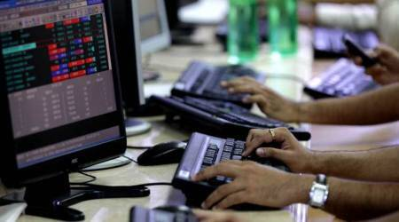 Sensex rises by 267 points; Rupee loses 17 paise