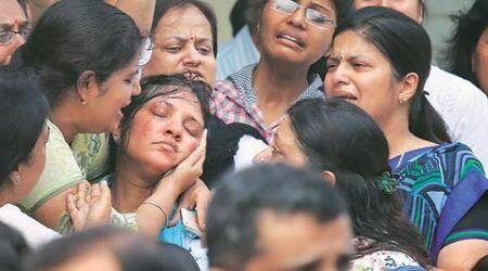 At Tarishi's funeral, a photograph tells the story
