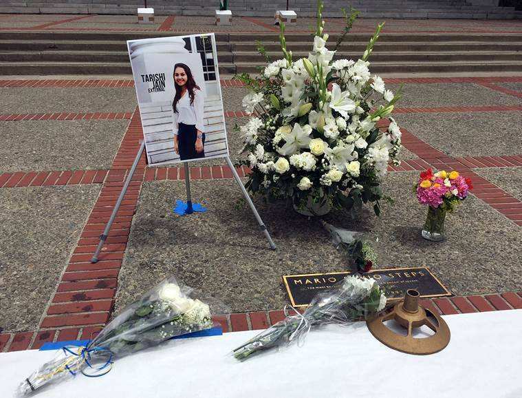 A flower memorial is seen on the steps of Sproul Plaza at University of California Berkeley on Tuesday, July 5, 2016 in Berkeley, Calif. The university held a vigil for Tarishi Jain, a student who was among the 20 hostages killed by militants in an attack on a restaurant in Bangladesh. Jain was in the capital of Dhaka for a summer internship that began last month. (AP Photo/Terry Chea)