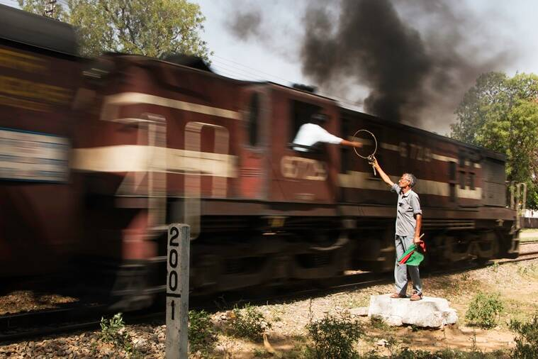 Some railway lines in India still use the Neill's Ball Token System which allows safe train operations on a single line section. Drivers collect the token from the man on the ground, while on the go at speeds approaching 100 kmph. (Photo: Shashanka Nanda)