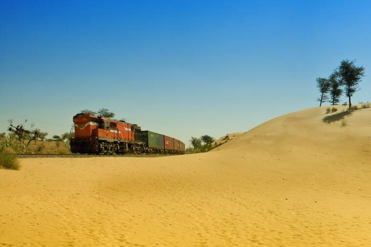 A passing freight train at Indon Ki Dhani, Rajasthan lends a dash of colour to the desert landscape. (Photo: Shashanka Nanda)