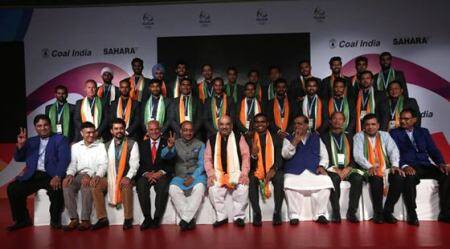 Indian Mens hockey team photograph with BJP Cheif Amit Shah and Sports Minister Vijay Goel and other dignitaries during a team investiture ceremony for the RIO Olympics in the capital New Delhi on tuesday. Express Photo by Tashi Tobgyal New Delhi 120716