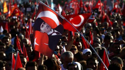 Supporters of the Republican People's Party, or CHP, wave Turkish flags with a portrait of Mustafa Kemal Ataturk, the founder of modern Turkey, at centre during a 'Republic and Democracy Rally' at Taksim square in central Istanbul, Sunday, July 24, 2016. Thousands of supporters of Turkey's main opposition group and some ruling party members rallied in Istanbul to denounce a July 15 coup attempt, a rare show of political unity that belied opposition unease over President Recep Tayyip Erdogan's crackdown since the failed uprising. (AP Photo/Petros Karadjias)