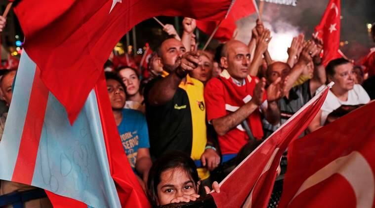 People wave Turkish flags as they gather in Taksim Square in Istanbul, protesting against the attempted coup, Wednesday, July 20, 2016. (AP Photo/Petros Giannakouris)