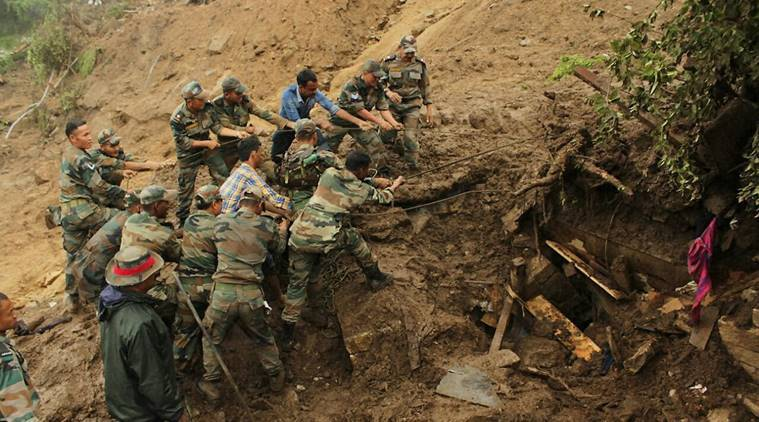 Pithoragarh: Army jawans search for survivors in the mud and debris of a destroyed house in landslide-hit, at Pithoragarh district of Uttarakhand on Saturday.PTI Photo(PTI7_2_2016_000157B)
