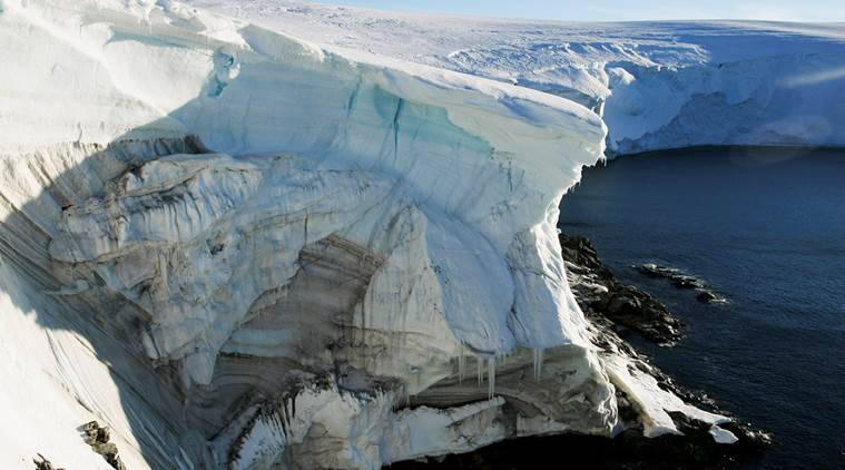 Melting ice shows through at a cliff face at Landsend, on the coast of Cape Denison, Antarctica January 2, 2010. REUTERS/Pauline Askin/File Photo