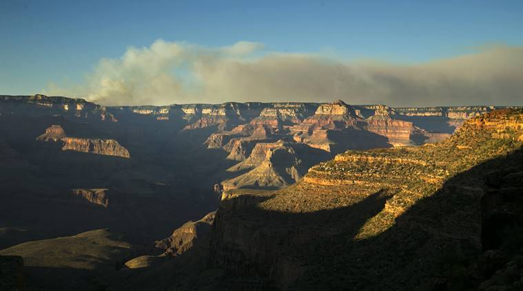 A wildfire burns on the north rim of the Grand Canyon as seen from the Bright Angel Trail below the south rim of the canyon in Grand Canyon National Park in Arizona, Thursday, July 14, 2016. (David Wallace/The Arizona Republic via AP)
