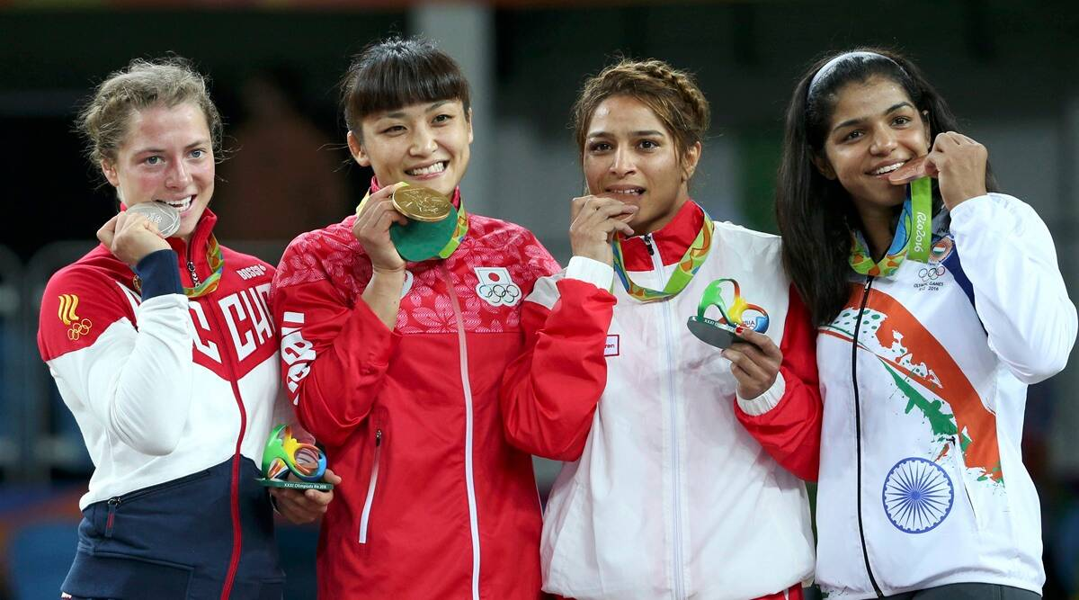 Here's why Olympians bite their medals when clicking pictures | Trending  News,The Indian Express