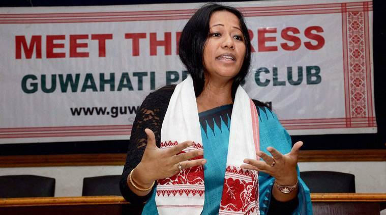 """Guwahati: Binalakshmi Nepram, Founder of Manipur Women Gun Survivors Network and Secretary General , Control Arms Foundation of India interacts with media persons at a """"Meet the Press"""" programme in Guwahati on Friday.  PTI Photo  (PTI8_26_2016_000139B)"""