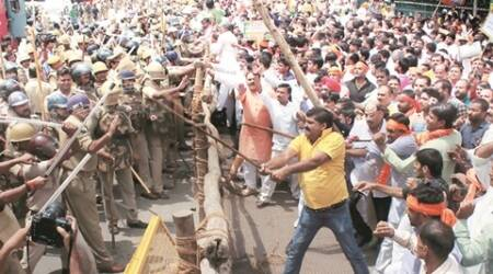 To protest 'jungle raj' in UP,  BJP workers hit the streets