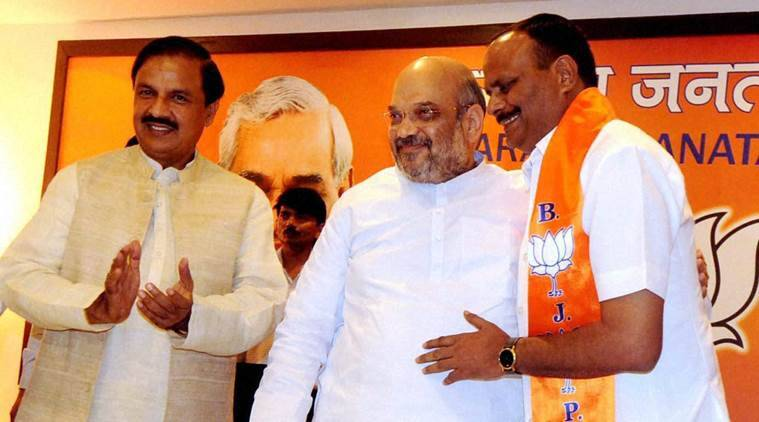 Brajesh Pathak with BJP President Amit Shah and Tourism Minister Mahesh Sharma after joining BJP in New Delhi on Monday. Pathak quit BSP to join BJP. PTI Photo