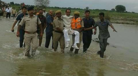 shivraj singh chouhan, mp, mp floods, madhya pradesh, shivraj singh carried my men, shivraj in water, shivraj chouhan in water, shivraj carried by police, shivraj in panna, shivraj singh chouhan scared, indian express editiorial, editorial, mp news, shivraj flood, shivraj image, india news