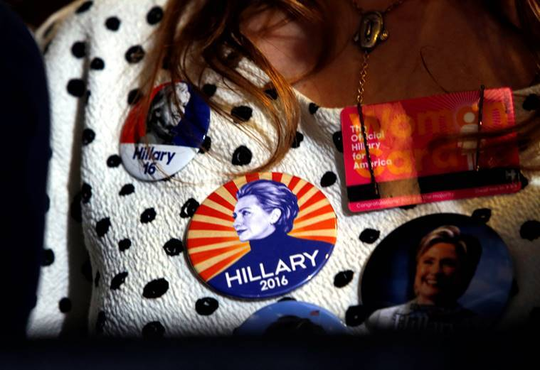 A supporter wears Democratic U.S. presidential nominee Hillary Clinton buttons during a Clinton campaign rally at the International Brotherhood of Electrical Workers (IBEW), Local 357, union hall in Las Vegas, Nevada, U.S., August 4, 2016. REUTERS/Steve Marcus