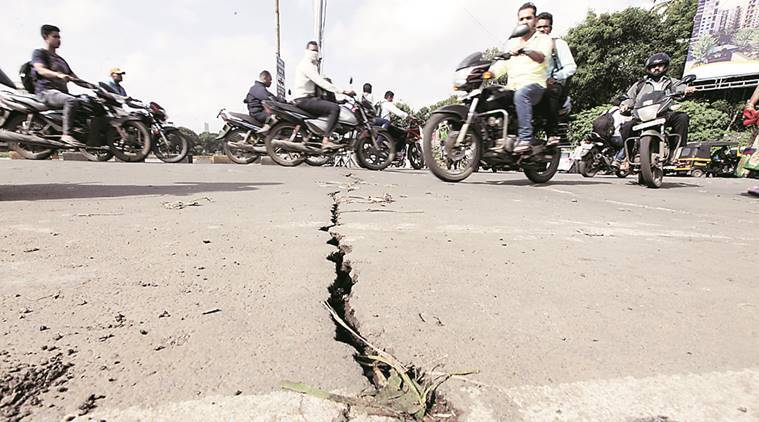 Damage was seen to the Bhide bridge which had got submerged under water during Wednesday rains. The cracks were noticed on Thursday after water receded. Express Photo By Pavan Khengre,04.08.16,Pune.