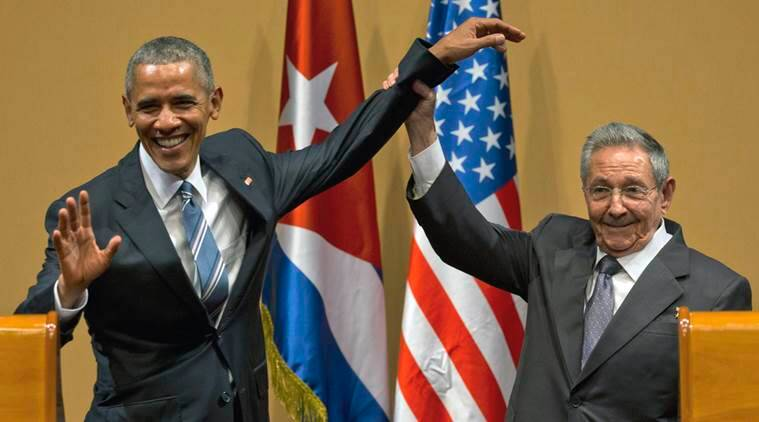 FILE - In this March 21, 2016 file photo, Cuban President Raul Castro, right, lifts up the arm of President Barack Obama at the conclusion of their joint news conference at the Palace of the Revolution, in Havana, Cuba. As Fidel Castro nears his 90th birthday on Aug. 13, the island's brightest economic hopes lies in a post-detente surge in tourism that's expected to boom when commercial flights to and from the United States, Cuba's longtime enemy, start again on Aug. 31. (AP Photo/Ramon Espinosa, File)