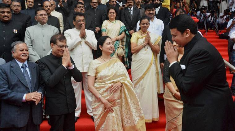 Maharashtra Chief Minister Devendra Fadnavis exchanges greetings with the dignitaries during 70th Independence Day programme at Mantralaya in Mumbai on Monday. PTI Photo