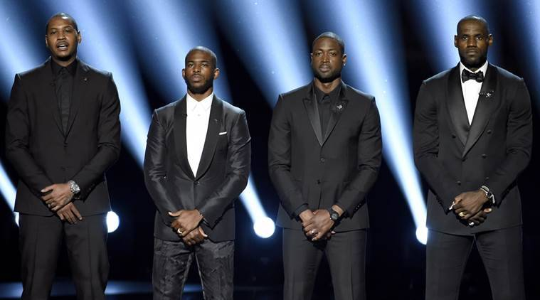 Chicago Bulls NBA star Dwayne Wade with  Carmelo Anthony, Chris Paul and LeBron James. A family spokesman says a cousin Wade was fatally shot Friday, Aug. 25. (Chris Pizzello/Invision/AP, File)