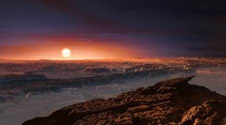 This artist rendering provided by the European Southern Observatory shows a view of the surface of the planet Proxima b orbiting the red dwarf star Proxima Centauri, the closest star to the Solar System. The double star Alpha Centauri AB also appears in the image to the upper-right of Proxima itself. Proxima b is a little more massive than the Earth and orbits in the habitable zone around Proxima Centauri, where the temperature is suitable for liquid water to exist on its surface.  (European Southern Observatory via AP)