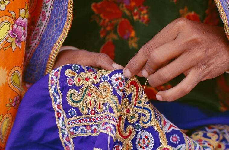 Ahir embroidery celebrates abundance and opulence. It is bright, colourful and dense.
