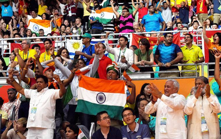 Rio de Janeiro : Supporters of India holding tricolor during a women's singles final match at the 2016 Summer Olympics in Rio de Janeiro, Brazil on Friday. PTI Photo by Atul Yadav(PTI8_19_2016_000334a)