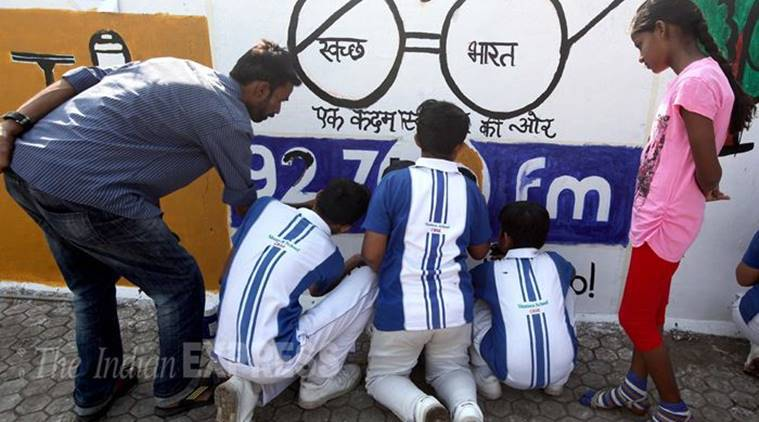(Representational) School children get together to paint messages of Swachh Bharat and the symbolic spectacles of Mahatma Gandhi on the occasion of Gandhi Jayanti in Vadodara Express Photo By Bhupendra Rana 02-10-2015