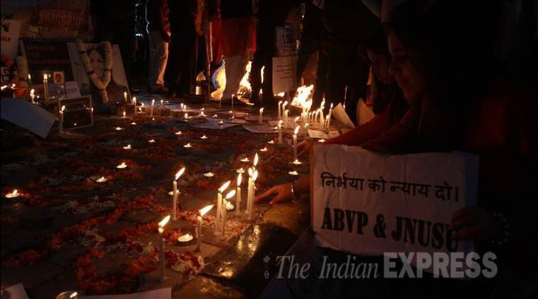 light candles to pay tribute to a brave girl Damini for remembering (Delhi gang rape victim) at Janter Manter in new delhi on Wednesday Express photo by prem nath pandey 16 dec 15