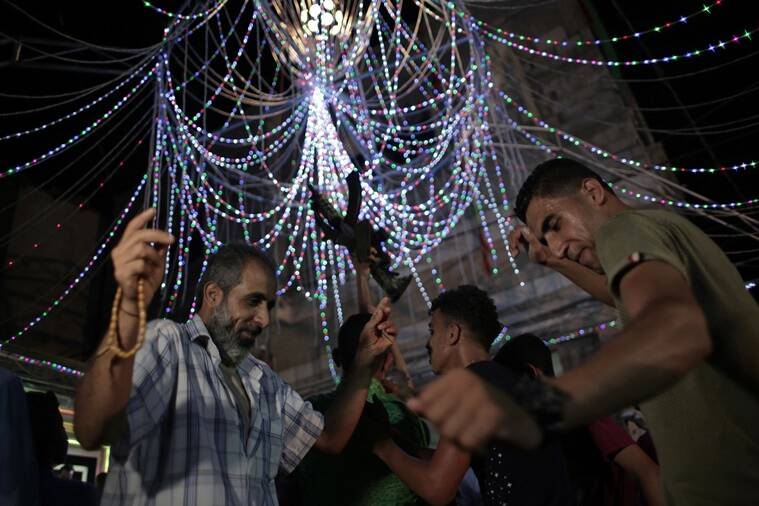 In this Thursday, July 28, 2016 photo, relatives of Palestinian groom Saed Abu Aser, dance in a party celebrating his wedding, in Gaza City. Weddings have emerged as a welcome celebration that slices through the often morose mood in the Gaza Strip, a Palestinian coastal territory run by the militant group Hamas. For both poor and well-off Gazans, weddings are a days-long, lavish affair of parties and dancing. (AP Photo/ Khalil Hamra)